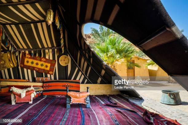 Interior of traditional Arabic Bedouin tent, Bait Ali Camp, Wadi Rum, Aqaba, Jordan