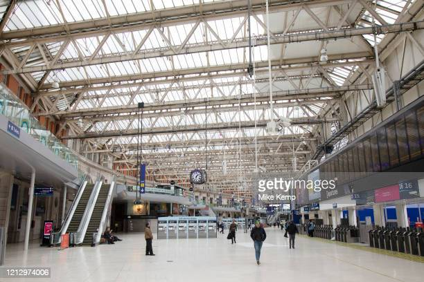 Interior of Waterloo Station which is normally full of commuters and travellers is eerily quiet and silent on empty streets as lockdown continues and...