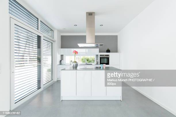 interior of white kitchen - electric stove burner stock pictures, royalty-free photos & images