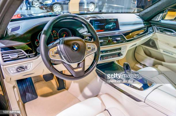 Interior on a BMW 7 series luxury limousine car The car is fitted with leather seats wood details and a large information display on the dahsboard...