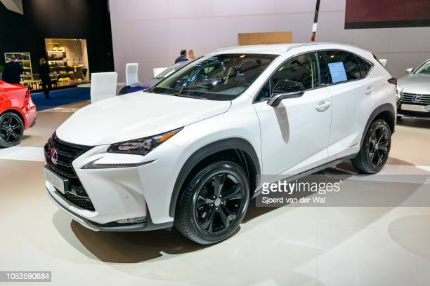 Interior on a Lexus NX300h hybrid SUV with red leather seats and information displays on the dashboard on display at Brussels Expo on January 13,...