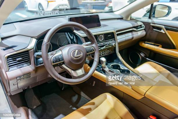 Interior on a Lexus RX450h hybrid SUV with tanned leather seats and information displays on the dashboard on display at Brussels Expo on January 13,...