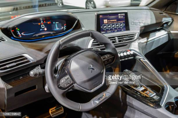 Interior on a Peugeot 5008 luxury crossover SUV fitted with leather seats and digital information displays on the dashboard on display at Brussels...
