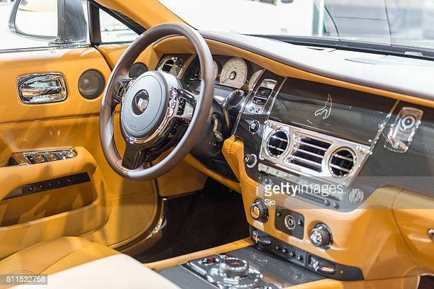 interior on a rolls royce wraith luxury coupe car - rolls royce stock photos and pictures