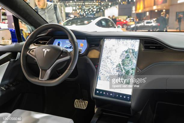 Interior on a Tesla Model X full electric luxury crossover SUV car with a large touch screen and carbon look dashboard on display at Brussels Expo on...