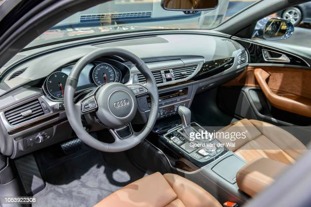Interior on an Audi A6 Berline luxury sedan with brown leather seats automatic gearbox and an information display on the dashboard on display at...
