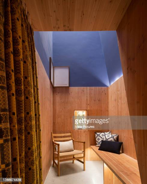 Interior roof-lit therapy room lined with Douglas Fir. Maggie's Centre at Velindre Hospital, Cardiff, United Kingdom. Architect: Dow Jones...