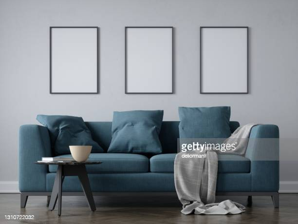 interior scene with 50cm x 70 cm blank frames - three objects stock pictures, royalty-free photos & images