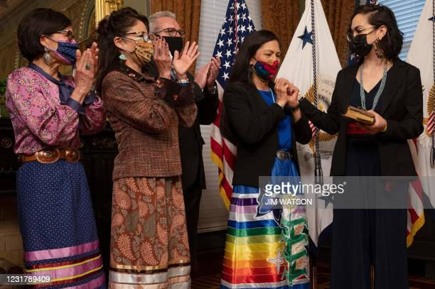 Interior Secretary Deb Haaland is joined by her family after being sworn in by US Vice President Kamala Harris on March 18, 2021 at the Eisenhower...