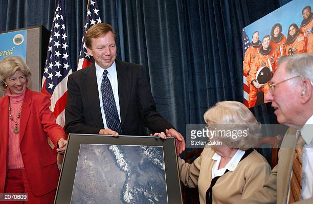 US Interior Secretary Gale A Norton Doug Dorothy and Judge Paul Brown of Arlington Virginia brother mother and father respectively of late astronaut...