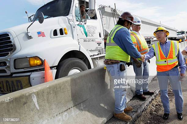 Interior Secretary Ken Salazar greets construction workers as he visits the Tamiami Trail Bridge Project in the Florida Everglades on October 20 2011...