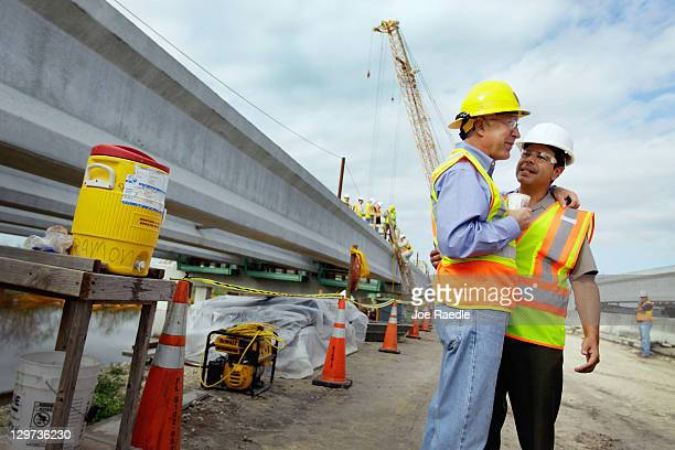 Interior Secretary Ken Salazar speaks with Big Cypress National Preserve Director Pedro Ramos as they visit the Tamiami Trail Bridge Project in the...