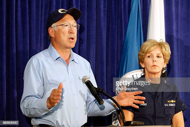 Interior Secretary Ken Salazar speaks with US Coast Guard Rear Admiral Mary Landry during a press conference about the response efforts oil spill...