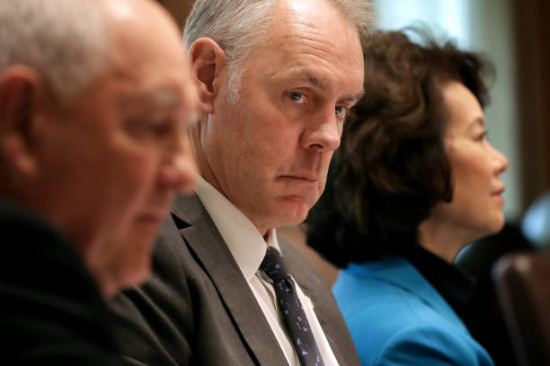 Interior Secretary Ryan Zinke ) attends a cabinet meeting with U.S. President Donald Trump in the Cabinet Room at the White House October 17, 2018 in...