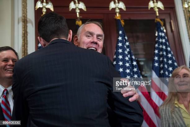 Interior Secretary Ryan Zinke facing camera greets Speaker Paul Ryan RWis during a swearing in ceremony for Rep Greg Gianforte RMont in the Capitol...