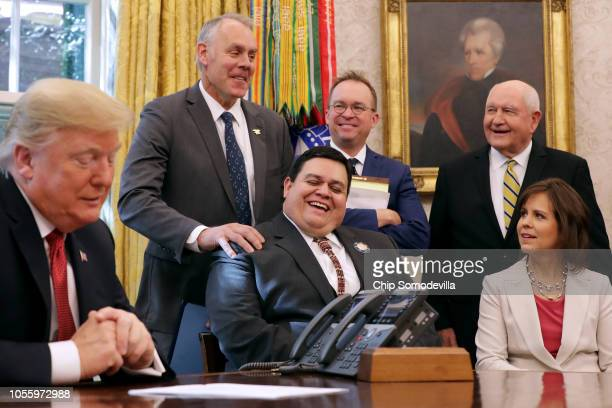 Interior Secretary Ryan Zinke jokes with Southern Ute Indian Tribe Councilman Adam Red after President Donald Trump introduced him during a meeting...