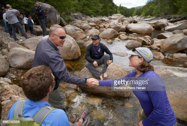 Interior Secretary Ryan Zinke shakes hands with Kelly Corbin at Orin Falls in the Katahdin Woods Waters National Monument on Wednesday June 14 2017...