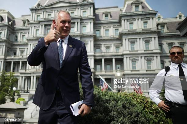 Interior Secretary Ryan Zinke talks to journalists outside the White House West Wing before attending a cabinet meeting with President Donald Trump...