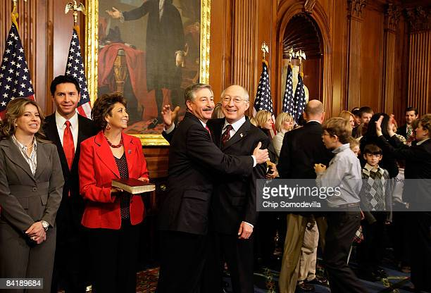 Interior Secretarydesignate Ken Salazar embraces his brother Rep John Salazar during the mock swearingin photographs in the Mansfield Room at the US...