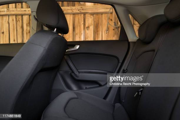 interior shot of backseat of new car - car interior stock pictures, royalty-free photos & images