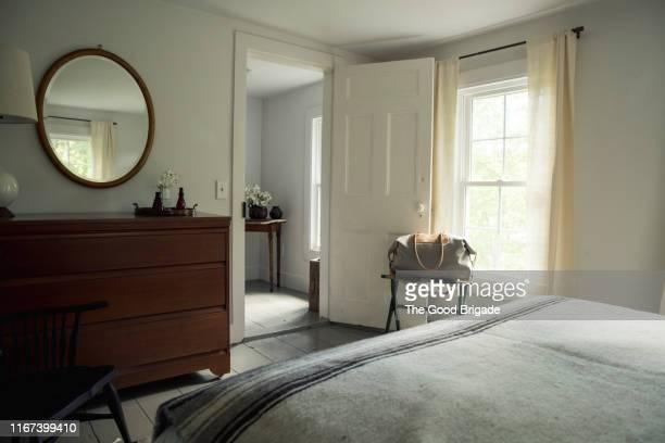 interior shot of bedroom in country home - slaapkamer stockfoto's en -beelden