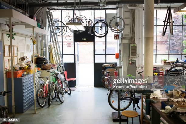interior shot of bike workshop - part of a series stockfoto's en -beelden