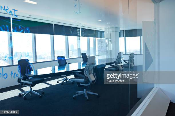 interior shot of modern designed boardroom in office building - soft focus stock pictures, royalty-free photos & images