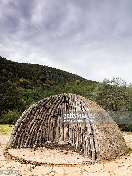 CONTENT] Interior sight of an ancient oven to make coal of the mountain with the trunks of wood piled up and ready to ignite them