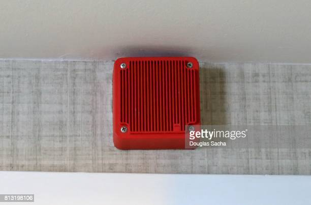 Interior smoke detector and alarm hanging on the wall