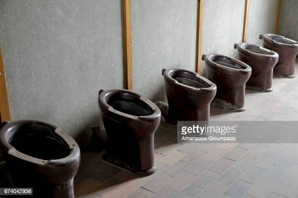 Interior toilet facilities in the reconstruction barracks of Dachau Concentration Camp Memorial Site on April 14 2017 in Dachau Germany Dachau was...