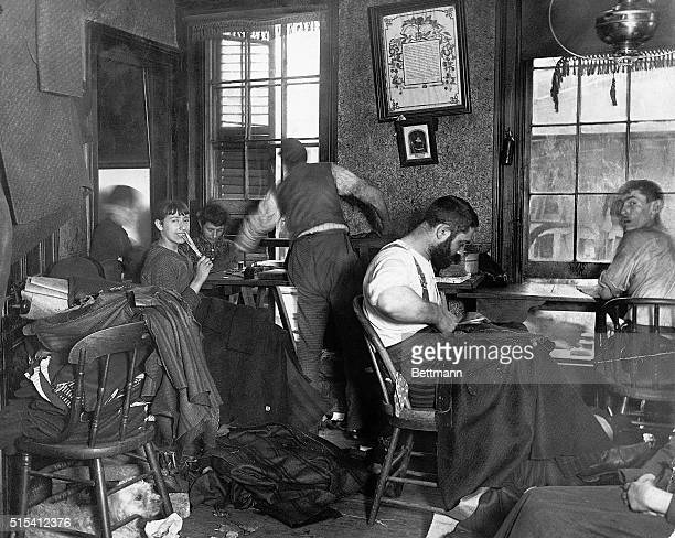 Interior view of a crowded tailor's workshop on Ludlow Street on New York's Lower East Side Knee pants paid at 45 cents per dozen Undated photograph...