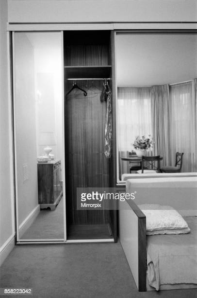 Interior view of a flat, showing the living room area, mirrored wardrobe and sofa bed, 29th October 1986.