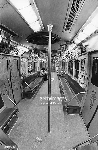 Interior view of a graffiticovered subway car New York New York February 25 1977