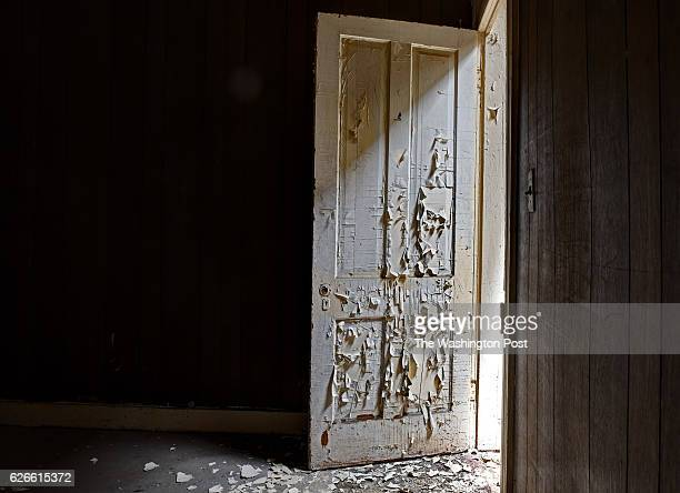 Interior view of a peeling door during the last days of a row of houses slated for demolition on June 2016 in Baltimore MD