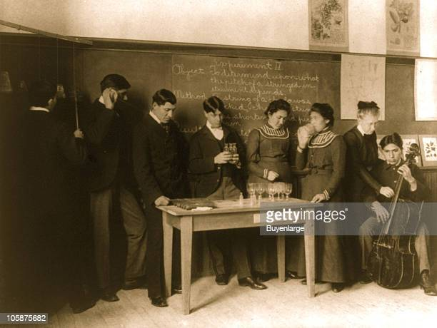 Interior view of a science classroom with both male and female students at Carlisle Indian School Carlisle PA 1901 The teacher is conducting a...
