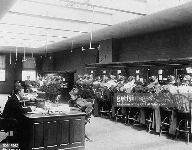 Interior view of a telephone exchange were primarily women work at banks of switchboards making connections, New York, New York, 1896.
