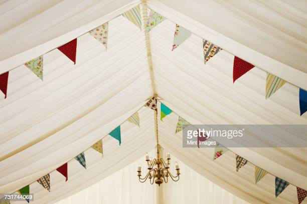 Interior view of a wedding marquee decorated with bunting.