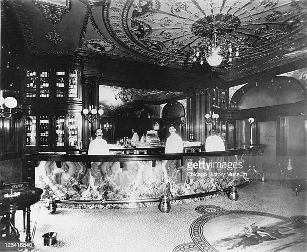 Interior view of Hannah Hoggs Saloon in the Fisher Building at 343 South Dearborn Street showing with three men behind bar and ornate architectural...