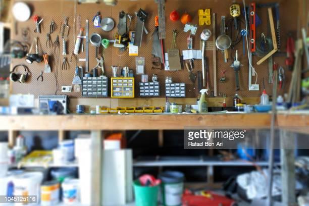 interior view of home garage workshop - rafael ben ari imagens e fotografias de stock