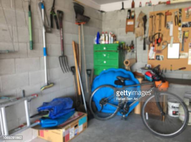 interior view of home garage workshop - rafael ben ari stockfoto's en -beelden