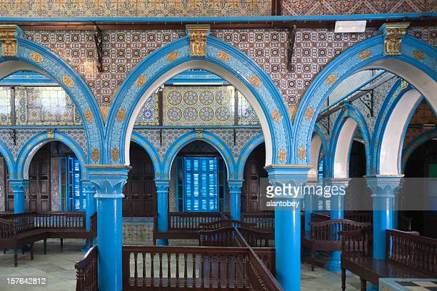 interior view of la ghriba synagogue on island of djerba - djerba stock pictures, royalty-free photos & images