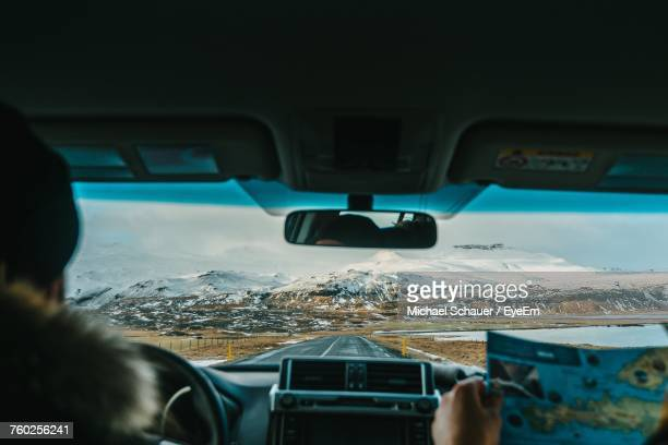 interior view of man driving car - windshield stock pictures, royalty-free photos & images
