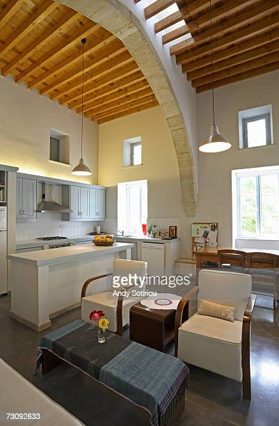 Interior view of Mediterranean style kitchen, dining and living area