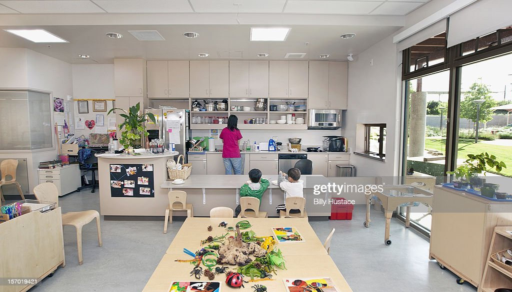Interior View Of Preschool Classroom And Kitchen Stock