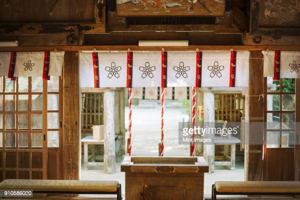 interior view of shinto sakurai shrine, fukuoka, japan. - shrine stock pictures, royalty-free photos & images