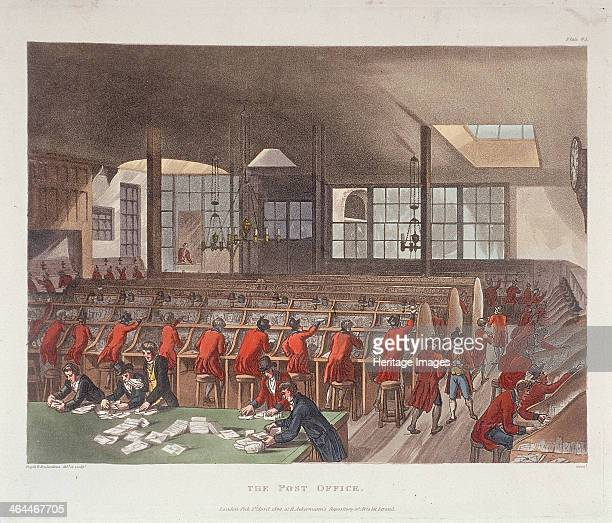 Interior view of sorting office in the General Post Office Lombard Street London 1809 Shows men sitting at desks in red coats and men at a large...