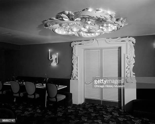 Interior view of the Blackstone Hotel, showing a door with ornate decoration around the doorway and on the ceiling, Omaha, NE, 1941. The hotel was...