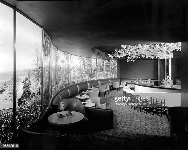 Interior view of the Blackstone Hotel, showing the dining room, with a wall mural, Omaha, NE, 1941. The hotel was located at 302 South 36th Street.