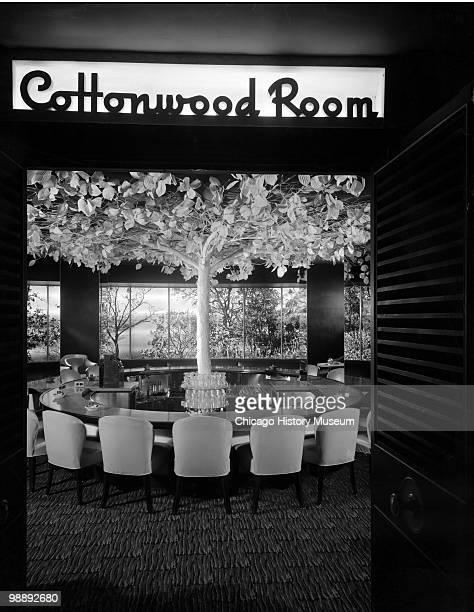 Interior view of the Blackstone Hotel, showing the entrance, with a �Cottonwood Room� sign above the doorway, and a large round table with chairs,...