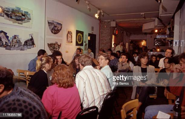 Interior view of the crowded upstairs lounge at the Knitting Factory nightclub, New York, New York, 1991.